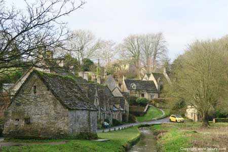 Bibury's infamous little yellow car alongside Arlington Row
